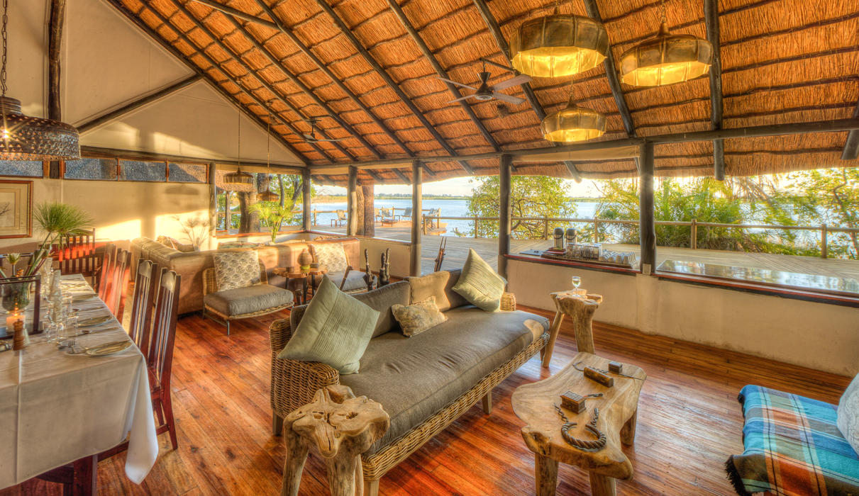 The indoor dining room and open plan lounge at Xugana Island Lodge