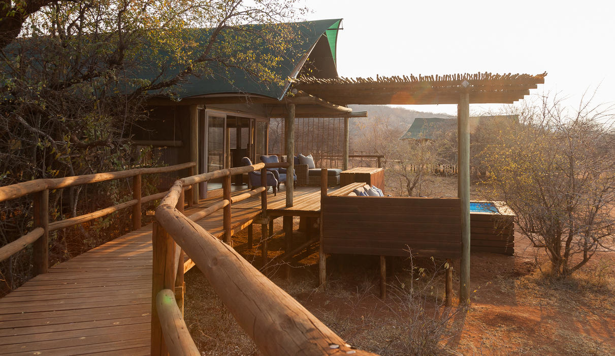 Traverse the bush on raised wooden walkways, to arrive at your own private paradise