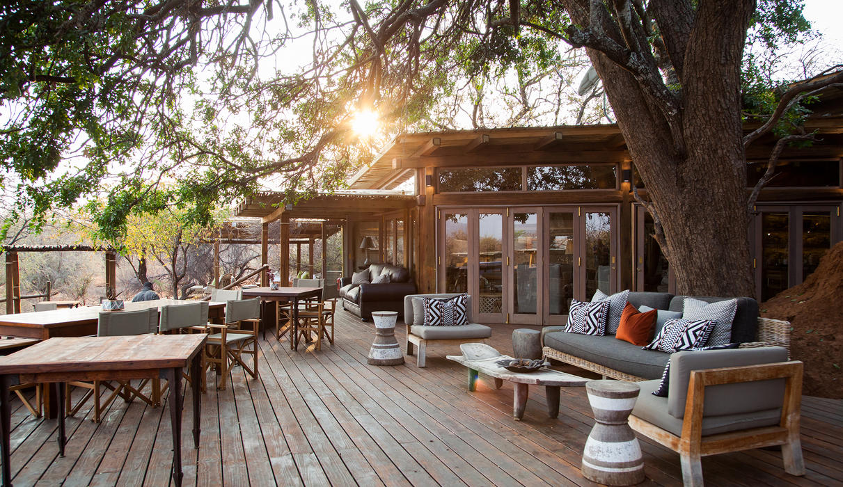 Enjoy sundowners and fine dining on the bright wooden decks, overlooking the expansive wilderness and it;s wild game.