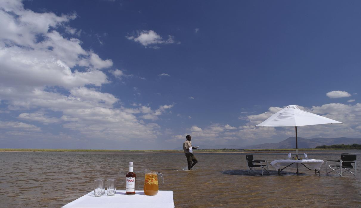 Dine with your toes in the cool Zambezi River