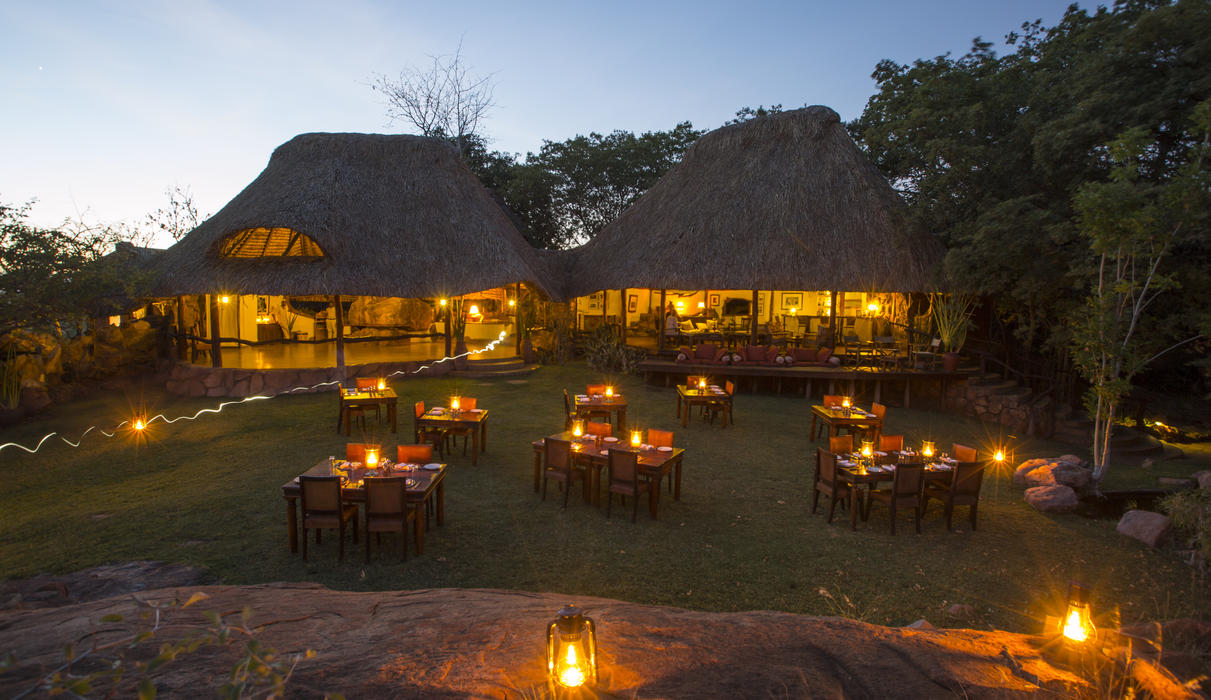 Dinner is always enjoyed under the stars - main bar, lounge and dining area with garden