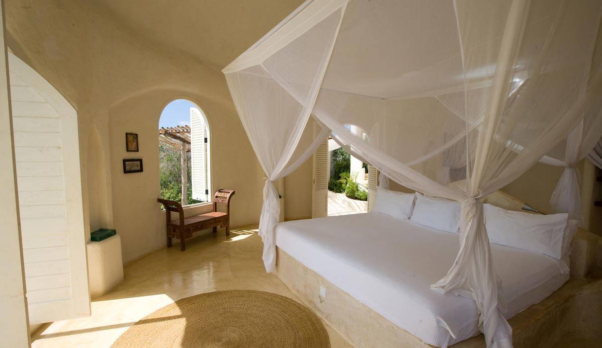 Open to the ocean breeze, a luxurious pavilion bedroom.