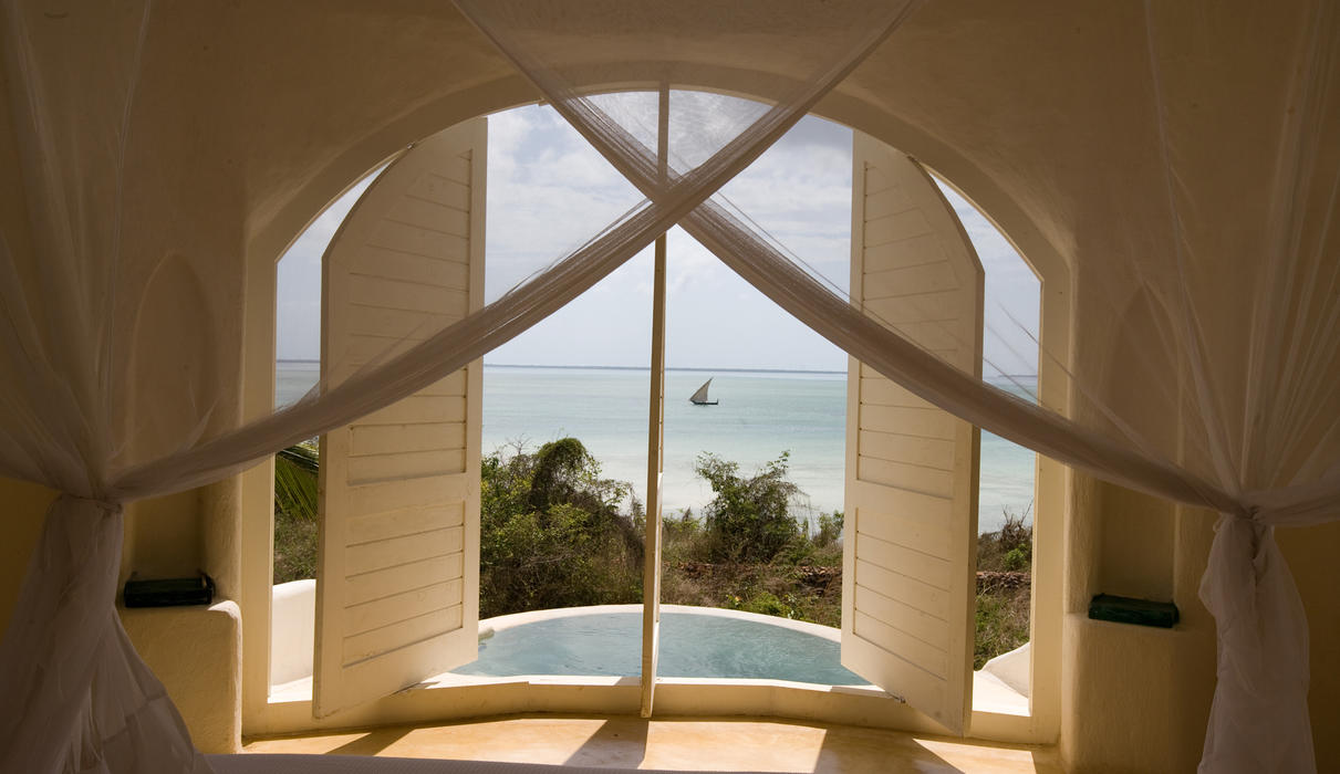Shuttered windows of a pavilion with views to the azure Indian Ocean