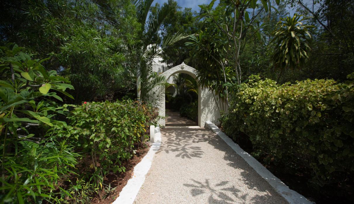 Walkways through the lush gardens of Kilindi