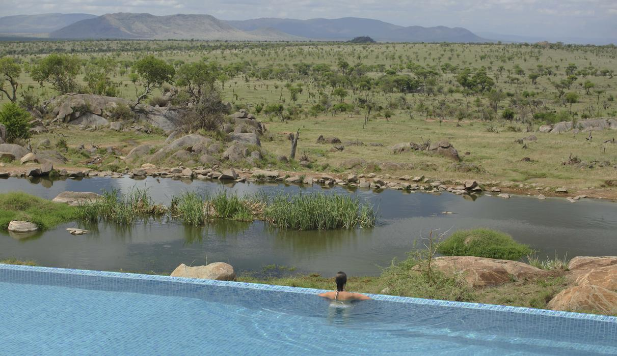 Enjoy uninterrupted views of the animal watering hole and Serengeti Plains beyond.