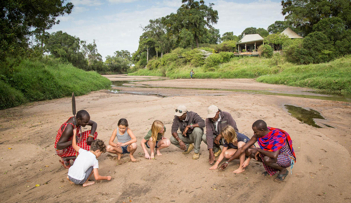 Kids enjoying some guided activities on the Sand River bed