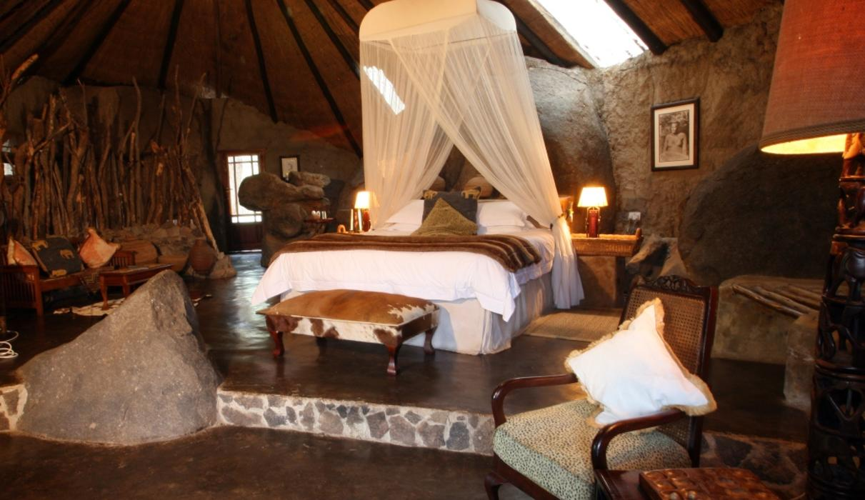 Suite 9 – The Lobengula Suite is elevated amongst the granite boulders & situated behind the main area and library. There are 90 steps up to Suite 9 so would be most suitable for those guests that don't mind a little uneven terrain. The suite consists of an ensuite bathroom with toilet, shower, outside shower, his & hers rock basins, tea & coffee stations, a lounge area, fan, mosquito net, mosquito coils, open wardrobe, private outside deck, king-size bed (suitable for extra tall guests), hairdryers & electric blankets.