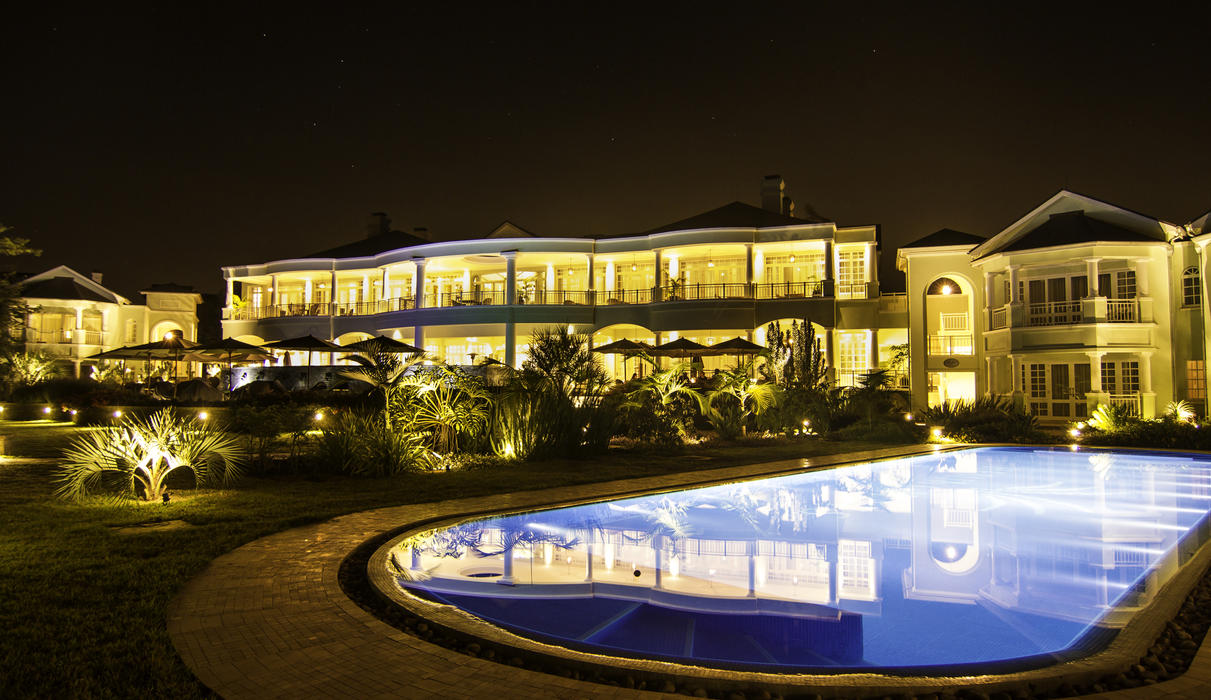 Spectacular night view of the hotel and pool