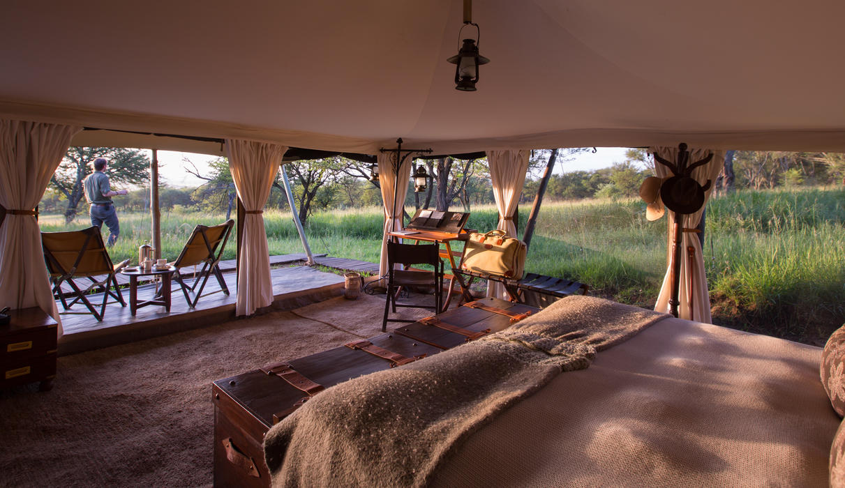 Large tents decorated in traditional safari-style furniture