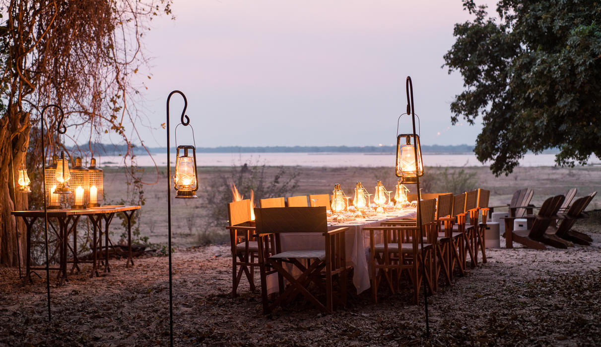 Family-style dining overlooking the river