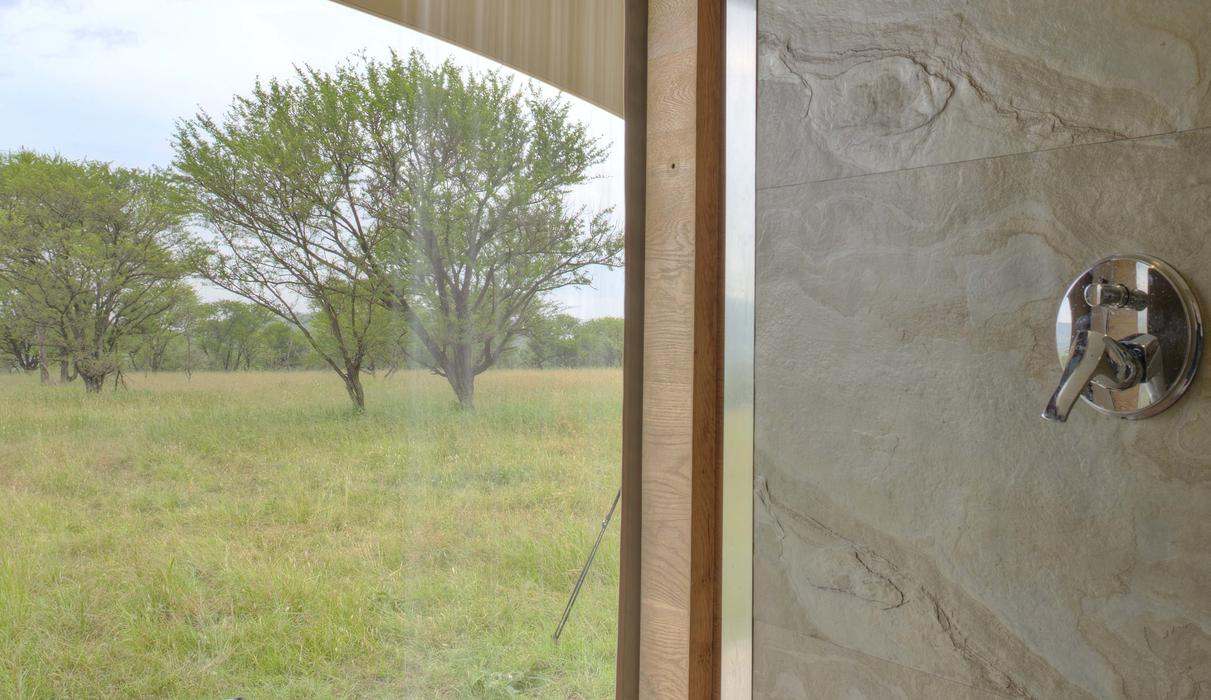 the shower area opens up to the Savannah and hot tub area