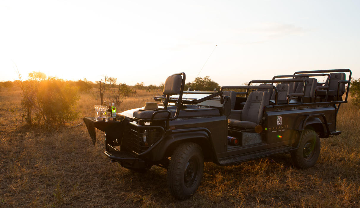 Luxuriously comfortable game drive vehicles, complete with sundowner bar