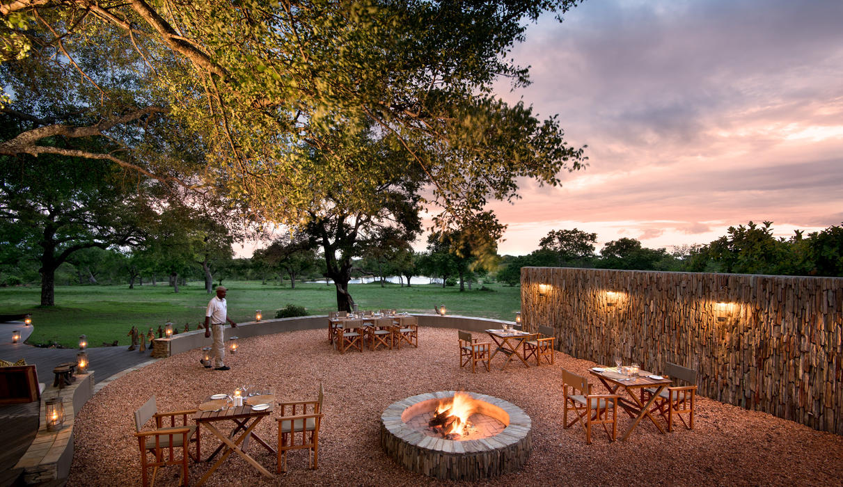 A warming fireside setting for an evening meal under the stars