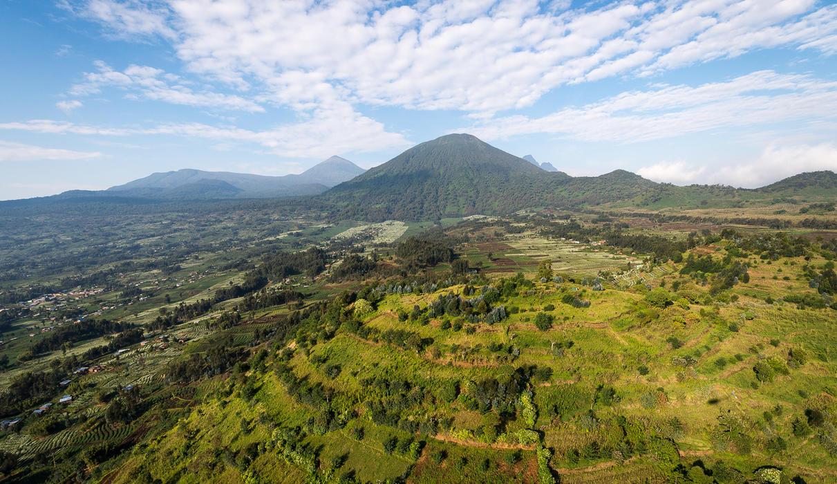 Bisate enjoys dramatic views of Bisoke and Karisimbi volcanoes