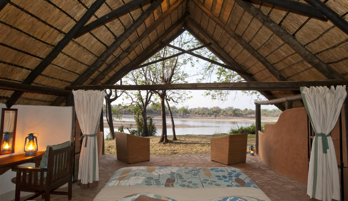Private open fronted chalets looking onto the Luangwa and Park