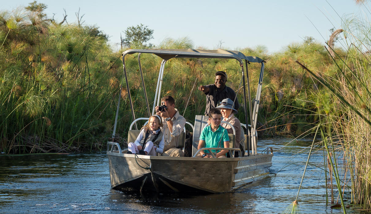 A boat excursion along an Okavango Delta channel