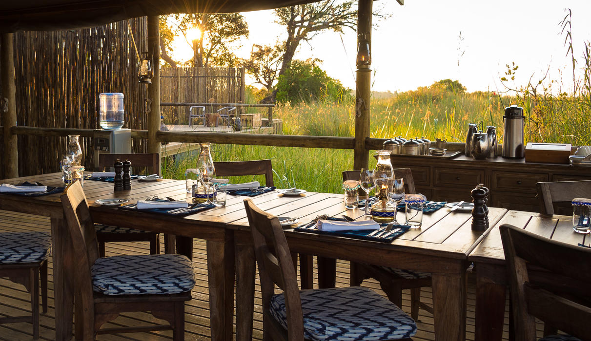 Little Vumbura's dining area overlooks a floodplain