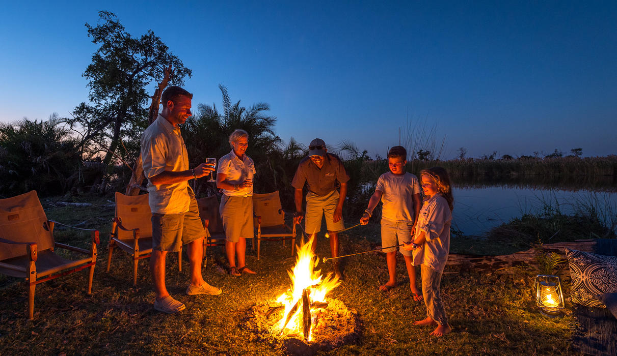 Sundowners around the fire inspire storytelling from the day's adventures