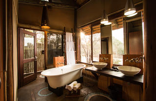 Rhino Post Safari Lodge - Bathroom and Outdoor Shower