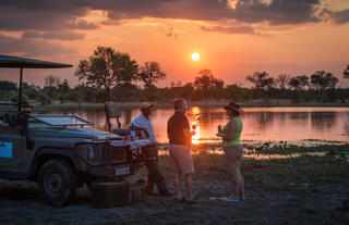 Sundowners on Safari at Machaba Camp