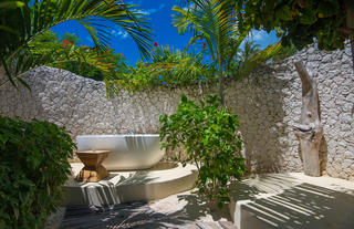 Outdoor bathtub in a luxury villa