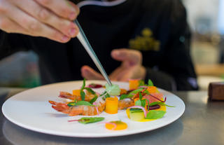 Chef preparing a seafood starter