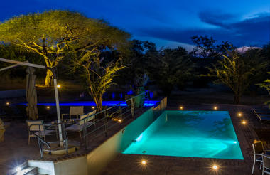Pool after sunset Chobe Bush Lodge