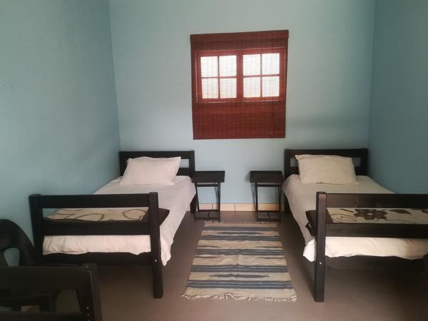 Basic Twin Room with shared bathroom