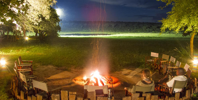 Boma & campfire overlooking floodlit waterhole