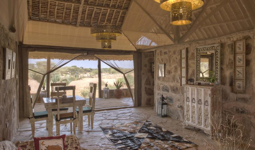 Retreat from the hot northern Kenya sun in this spacious shared lounge in the new Family Banda