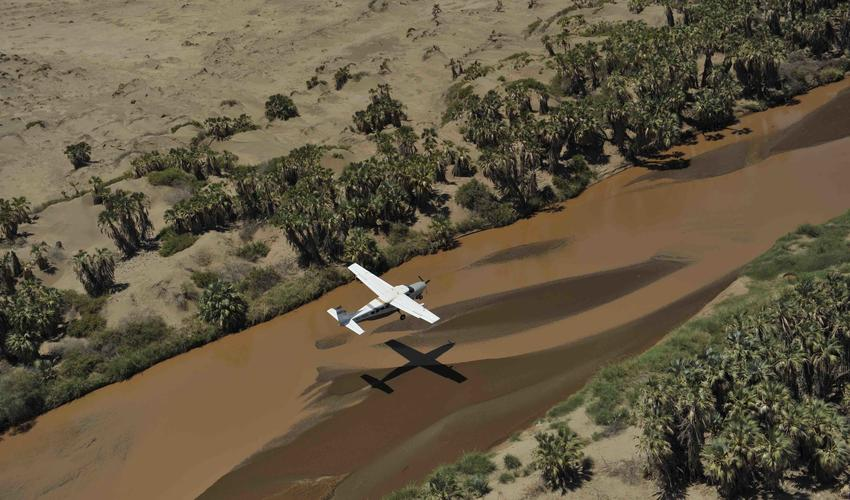 Fly low across stunning Samburu landscapes & rivers in our Cessna 2016