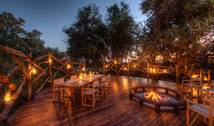 Enjoy a delicious meal out on the deck with great views and warm camp fire