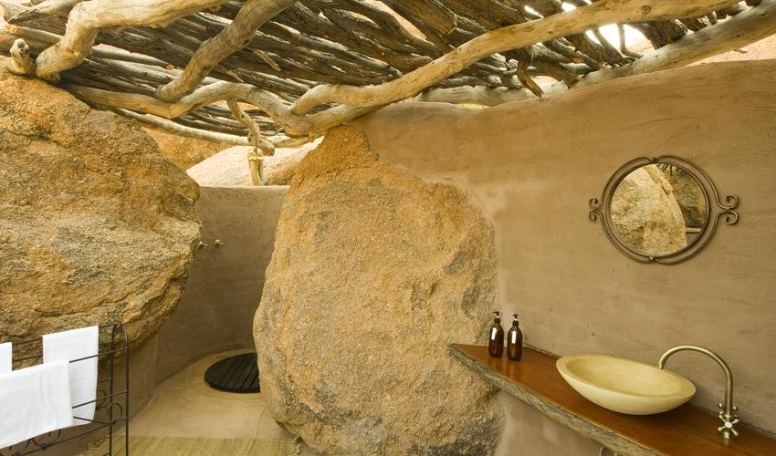 Inside the dome shaped space, you feel like entering a secluded cave and becoming one with the landscape.