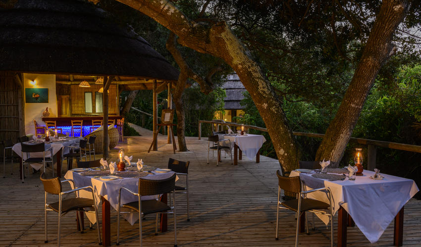 Dining Deck in the evening with the Bar in the background