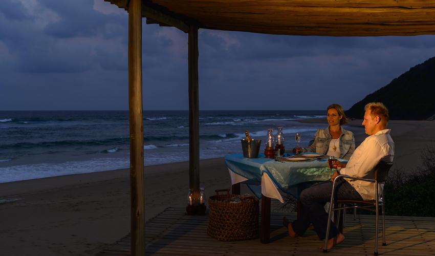 Candlelit Beach Deck dinner overlooking the ocean