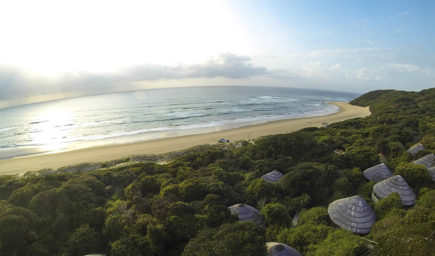 Aerial picture of Thonga Beach Lodge and the ocean behind