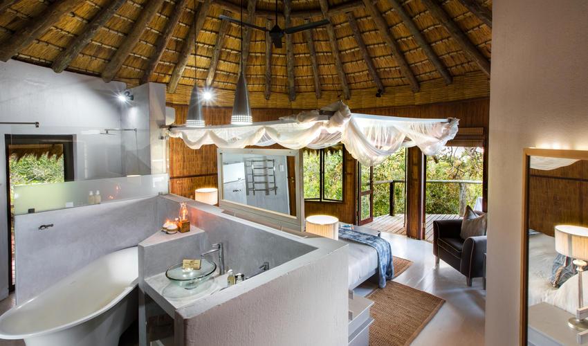 Deluxe Ocean View Family Suite main bedroom & bathroom