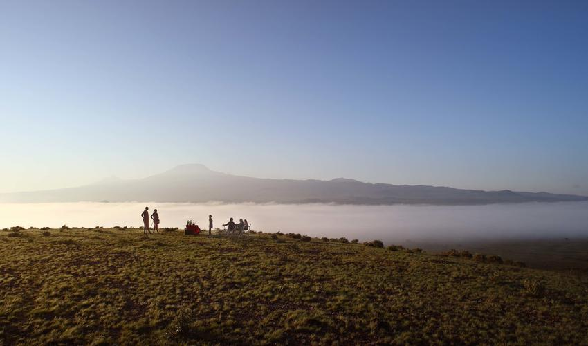 Sundowners overlooking Kilimanjaro