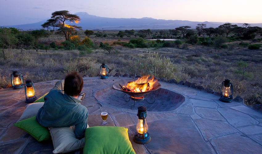 Camp fire with views of Mt. Kilimanjaro