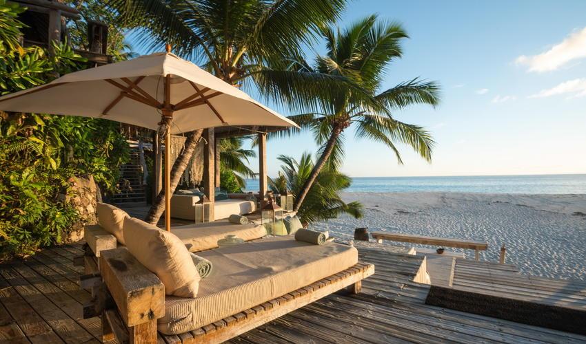 Villa North Island's extensive decks cascade down to the beach