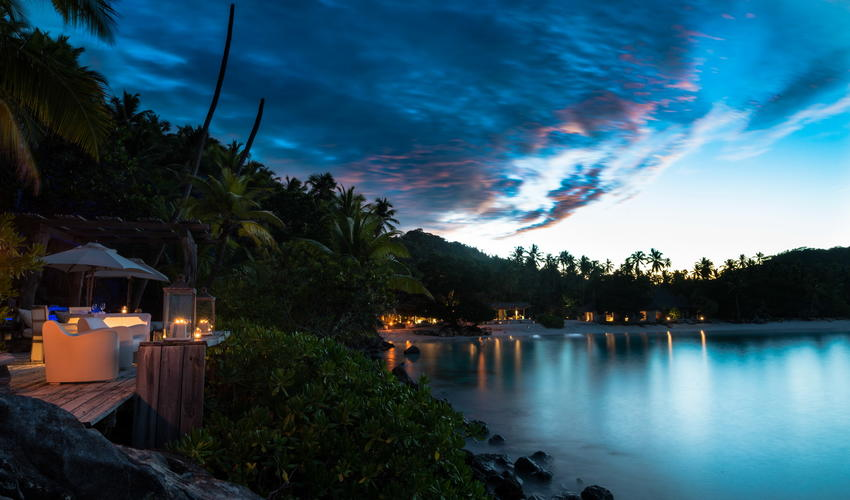 Sunset over North Island with the inviting lights of the Island Piazza