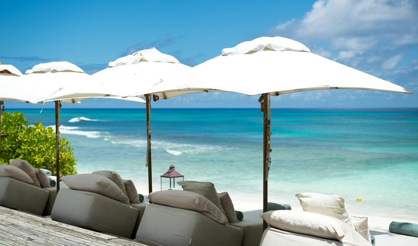 Beach umbrellas by the Island Piazza, overlooking East Beach and the Indian Ocean