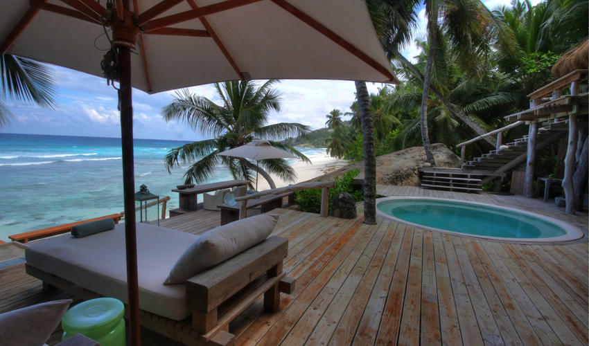 Villa North Island Deck, with the blue of the plunge pool echoing the ocean beyond