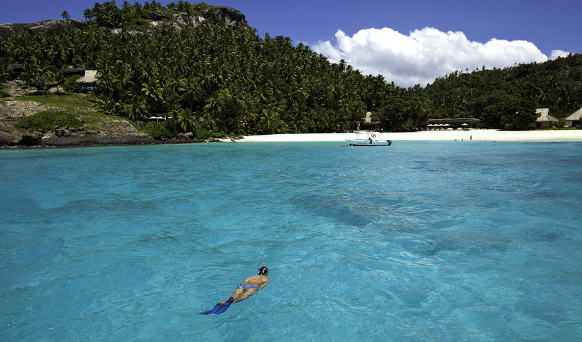Snorkelling in the crystal-clear seas off East Beach