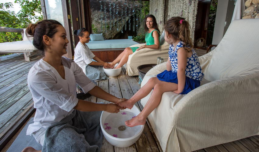 The barefoot ritual forms part of the warm welcome to the Island