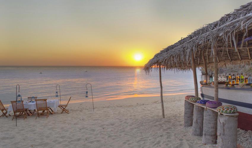 dining on beach with beach bar