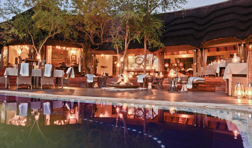 After an exciting game drive, enjoy supper under the stars overlooking the waterhole
