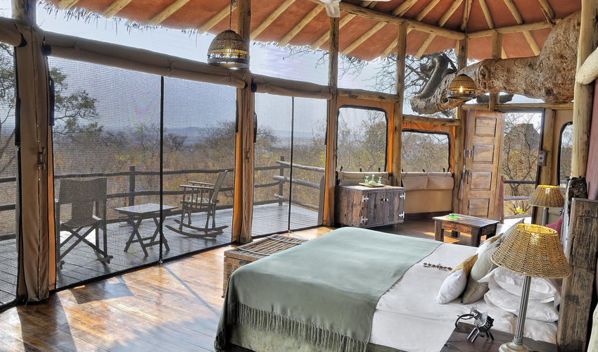 Earthy colours and natural materials decorate the interiors of the elevated treehouse suites