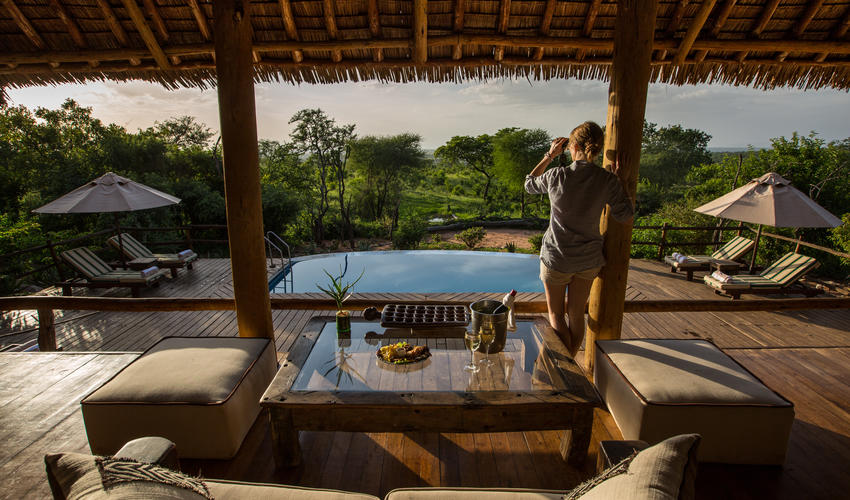 Lounge room overlooking the pool and waterhole