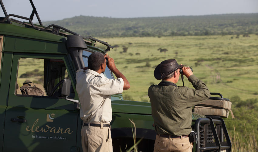Game driving with views over the Tarangire plains